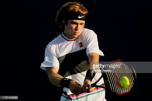 Andrey Rublev of Russia returns a shot to Taro Daniel of Japan during Day 4 of the Miami Open Presented by Itau at Hard Rock Stadium on March 21 2019...