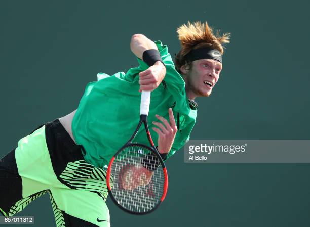 Andrey Rublev of Russia serves against Florian Mayer of Germany during Day 4 of the Miami Open at Crandon Park Tennis Center on March 23 2017 in Key...