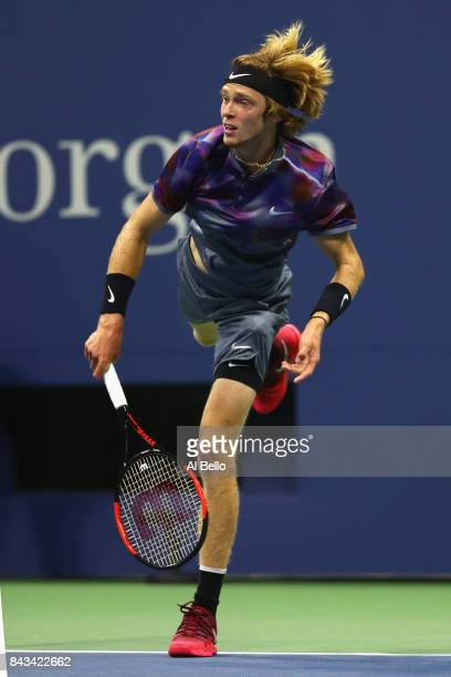 Andrey Rublev of Russia serves against Rafael Nadal of Spain during their Men's Singles Quarterfinal match on Day Ten of the 2017 US Open at the USTA...