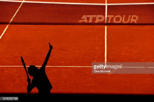 Andrey Rublev of Russia serves in his mens singles match against Tommy Paul of The United States during day six of the Mutua Madrid Open at La Caja...