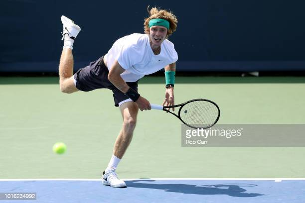 Andrey Rublev of Russia serves to Kei Nishikori of Japan during Day 3 of the Western and Southern Open at the Lindner Family Tennis Center on August...