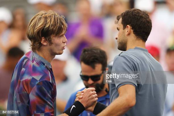 Andrey Rublev of Russia shakes hands after defeating Grigor Dimitrov of Bulgaria during their second round Men's Singles match on Day Four of the...