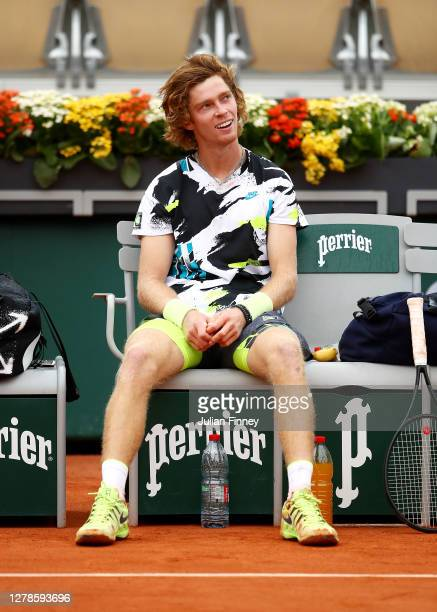 Andrey Rublev of Russia smiles as he sits down following victory in his Men's Singles fourth round match against Marton Fucsovics of Hungary on day...