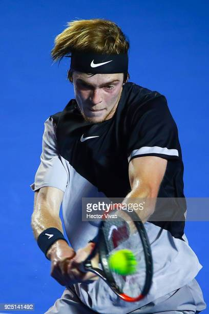 Andrey Rublev of Russia takes a backhand shot during the match between David Ferrer of Spain and Andrey Rublev of Russia as part of the Telcel...