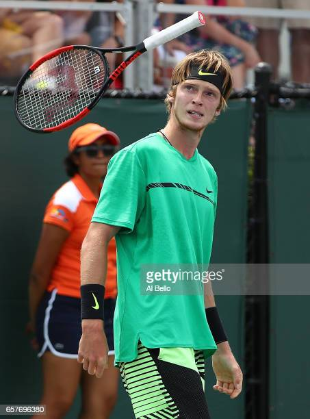 Andrey Rublev of Russia throws his raquet after dropping the first set against Tomas Berdych of the Czech Republic during day 6 of the Miami Open at...