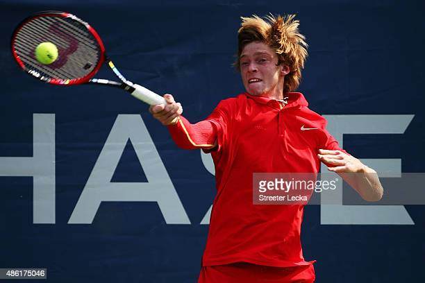 Andrey Rublev of Russian returns a shot to Kevin Anderson of South Africa during their Men's Singles First Round match on Day Two of the 2015 US Open...