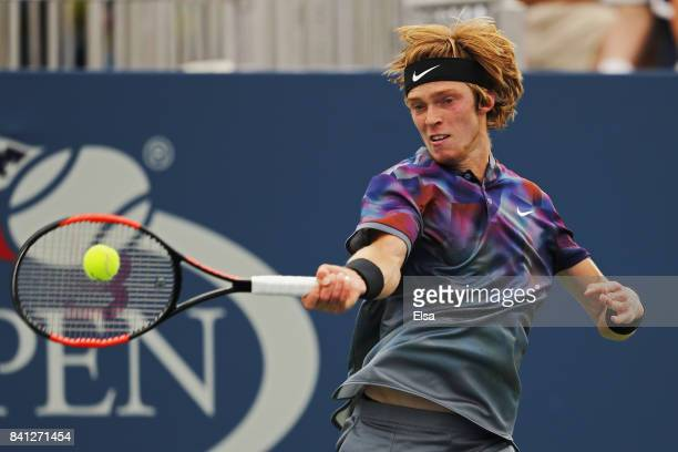 Andrey Rublev of Russiareturns a shot against Grigor Dimitrov of Bulgaria during their second round Men's Singles match on Day Four of the 2017 US...