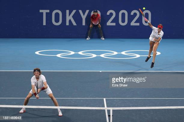 Andrey Rublev of Team ROC and Anastasia Pavlyuchenkova of Team ROC play Ashleigh Barty of Team Australia and John Peers of Team Australia in their...