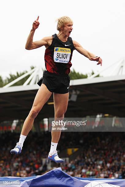 Andrey Silnov of Russia celebrates on his way to winning the Mens High Jump during the Aviva London Grand Prix at Crystal Palace on August 6, 2011 in...