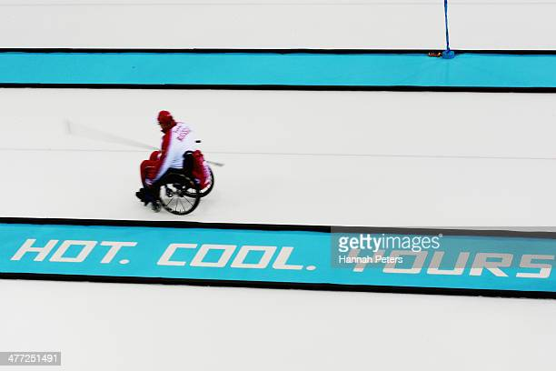 Andrey Smirnov of Russia changes ends during the wheelchair curling mixed round robin match between Canada and Russia at the Ice Cube Curling Center...