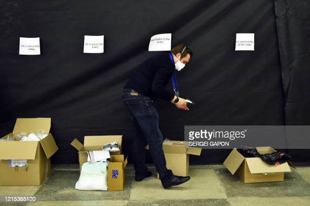 Andrey Stryzhak, a coordinator of the ByCovid19 volunteer movement, sorts respirators in a warehouse in Minsk, on May 22, 2020. - The volunteers for...