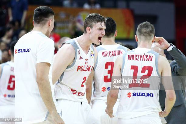 Andrey Vorontsevich and Adam Waczynski of the Russia National Team react during the match against the Poland National Team during the 2nd round of...