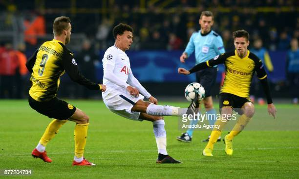 Andrey Yarmolenko and Julian Weigl of Borussia Dortmund in action against Dele Alli of Tottenham Hotspur FC during the UEFA Champions League Group H...