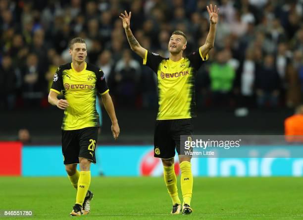 Andrey Yarmolenko of Borussia Dortmund celebrates scoring his sides first goal with Lukasz Piszczek of Borussia Dortmund during the UEFA Champions...