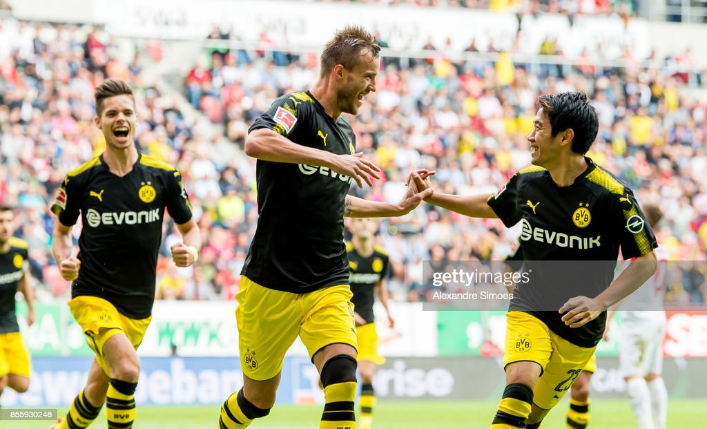 Andrey Yarmolenko of Borussia Dortmund cheers after scoring his team's 1th goal with Shinji Kagawa of Borussia Dortmund during the Bundesliga match between FC Augsburg and Borussia Dortmund at WWK-Arena on September 30, 2017 in Augsburg, Germany.