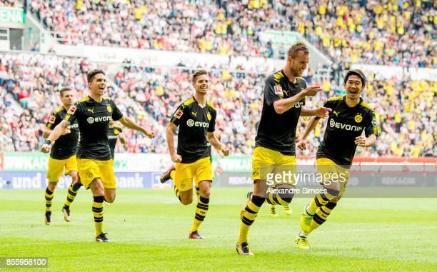 Andrey Yarmolenko of Borussia Dortmund cheers after scoring his team's 1th goal during the Bundesliga match between FC Augsburg and Borussia Dortmund...