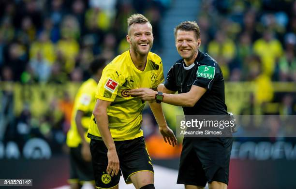 Andrey Yarmolenko of Borussia Dortmundtogether with referee Patrick Ittrich during the Bundesliga match between Borussia Dortmund and 1 FC Koeln at...