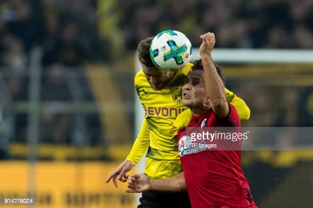 Andrey Yarmolenko of Dortmund and Amir Abrashi of Freiburg battle for the ball during the Bundesliga match between Borussia Dortmund and SportClub...