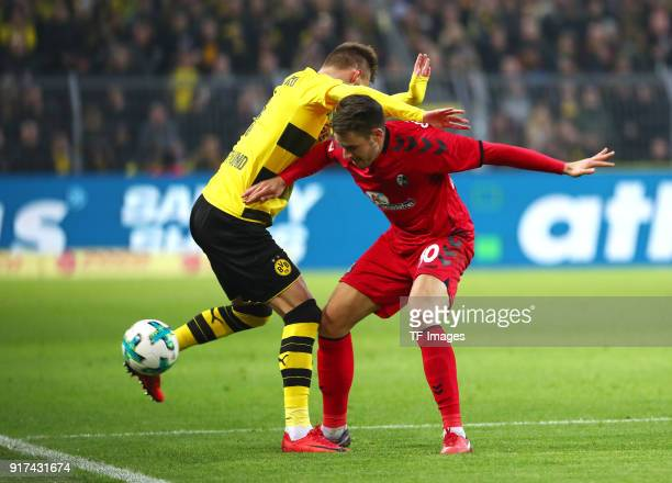 Andrey Yarmolenko of Dortmund and Christian Guenter of Freiburg battle for the ball during the Bundesliga match between Borussia Dortmund and...