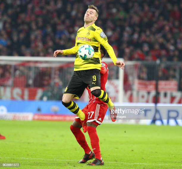 Andrey Yarmolenko of Dortmund and David Alaba of Muenchen battle for the ball during the DFB Cup match between Bayern Muenchen and Borussia Dortmund...