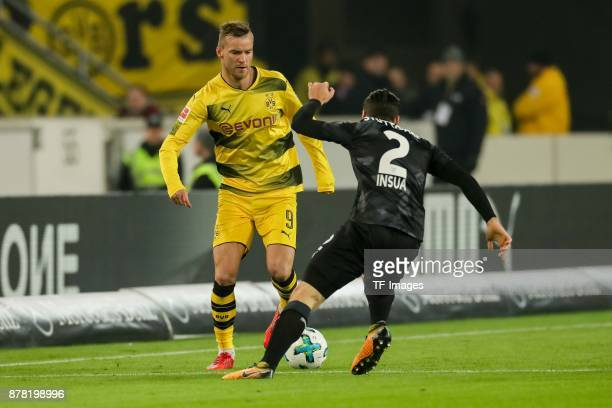 Andrey Yarmolenko of Dortmund and Emiliano Insua of Stuttgart battle for the ball during the Bundesliga match between VfB Stuttgart and Borussia...