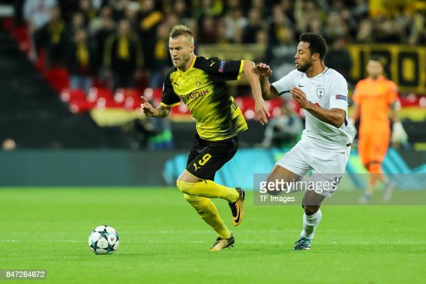 Andrey Yarmolenko of Dortmund and Mousa Dembele of Tottenham Hotspur battle for the ball during the UEFA Champions League group H match between...