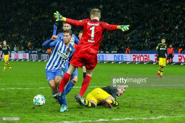 Andrey Yarmolenko of Dortmund and Niklas Stark of Hertha battle for the ball during the Bundesliga match between Hertha BSC and Borussia Dortmund at...