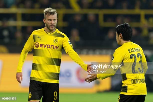 Andrey Yarmolenko of Dortmund and Shinji Kagawa of Dortmund battle for the ball during the Bundesliga match between Borussia Dortmund and VfL...
