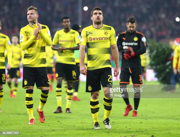 Andrey Yarmolenko of Dortmund and Sokratis Papastathopoulos of Dortmund look dejected after the DFB Cup match between Bayern Muenchen and Borussia...