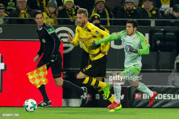 Andrey Yarmolenko of Dortmund and William of Wolfsburg battle for the ball during the Bundesliga match between Borussia Dortmund and VfL Wolfsburg at...