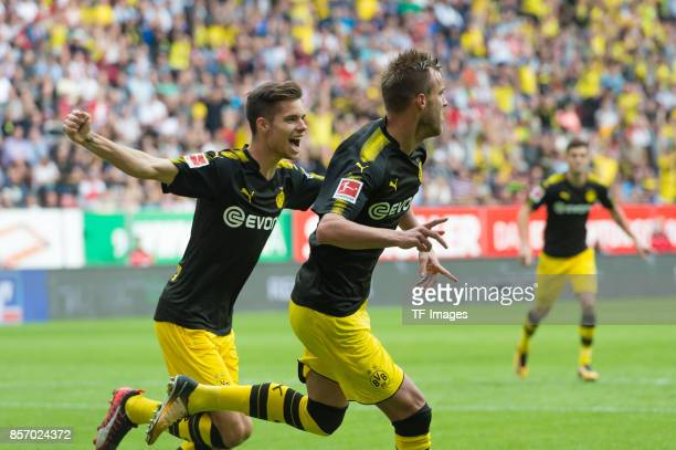 Andrey Yarmolenko of Dortmund celebrates after scoring his team`s first goal during the Bundesliga match between FC Augsburg and Borussia Dortmund at...