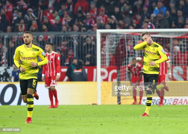 Andrey Yarmolenko of Dortmund celebrates after scoring his team`s first goal with Jeremy Toljan of Dortmund during the DFB Cup match between Bayern...