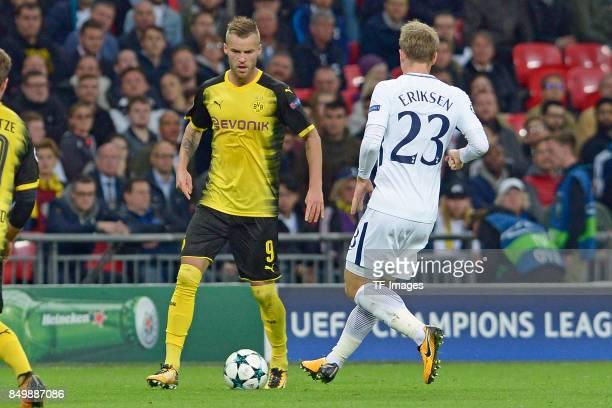 Andrey Yarmolenko of Dortmund Christian Eriksen of Tottenham battle for the ball during the UEFA Champions League group H match between Tottenham...