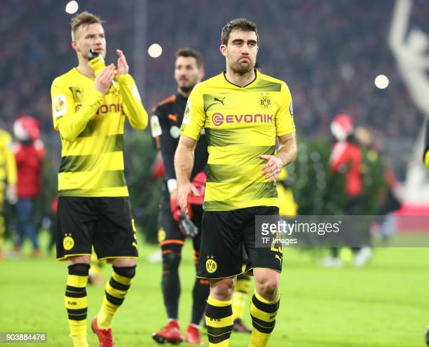 Andrey Yarmolenko of Dortmund Goalkeeper Roman Buerki of Dortmund and Sokratis Papastathopoulos of Dortmund gesture after the DFB Cup match between...