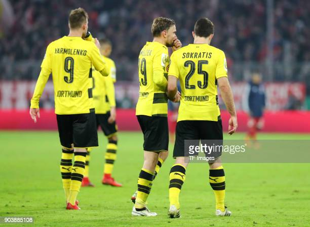 Andrey Yarmolenko of Dortmund Marcel Schmelzer of Dortmund and Sokratis Papastathopoulos of Dortmund look dejected after the DFB Cup match between...