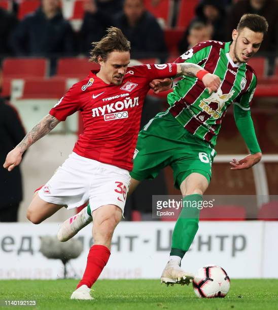 Andrey Yeshchenko of FC Spartak Moscow and Artur Sagitov of FC Rubin Kazan vie for the ball during the Russian Premier League match between FC...
