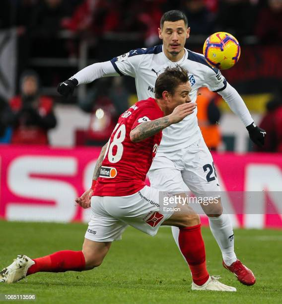 Andrey Yeshchenko of FC Spartak Moscow vies for the ball with PaulViorel Anton of FC Kr Sovetov Samara during the Russian Premier League match...