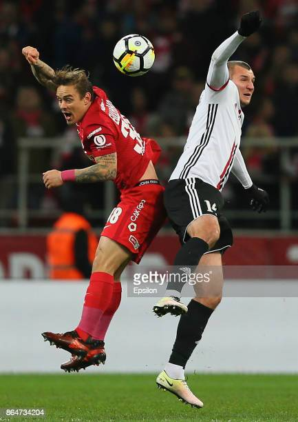 Andrey Yeshchenko of FC Spartak Moscow vies for the ball with Stanislav Prokofyev of FC Amkar Perm during the Russian Premier League match between FC...