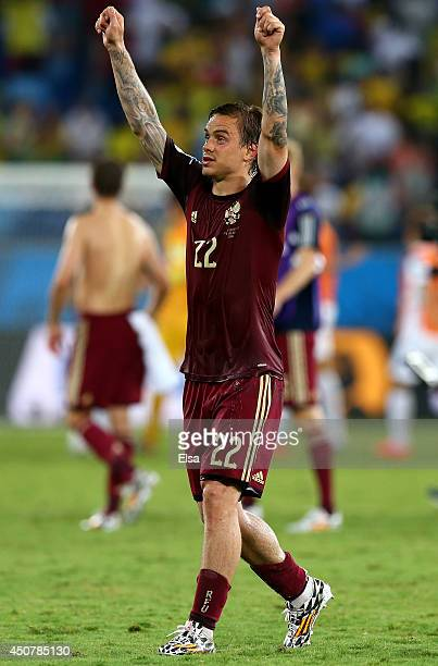 Andrey Yeshchenko of Russia acknowledges the fans after a 11 draw in the 2014 FIFA World Cup Brazil Group H match between Russia and South Korea at...