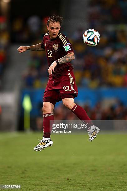 Andrey Yeshchenko of Russia goes up for a header during the 2014 FIFA World Cup Brazil Group H match between Russia and South Korea at Arena Pantanal...