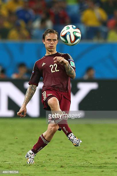 Andrey Yeshchenko of Russia strikes the ball during the 2014 FIFA World Cup Brazil Group H match between Russia and South Korea at Arena Pantanal on...