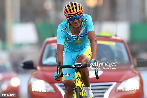 Andrey Zeits of Kazakhstan reacts after finishing eighth in the Men's Road Race on Day 1 of the Rio 2016 Olympic Games at the Fort Copacabana on...