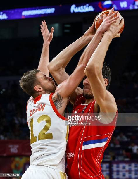 Andrey Zubkov of Russia in action against Boban Marjanovic of Serbia during the FIBA Eurobasket 2017 semi final basketball match between Russia and...