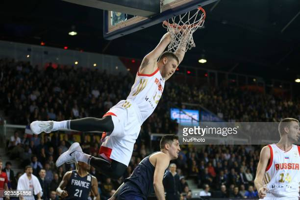 Andrey Zuubkov 12 of Russia and Paul Lacombe 90 of France during FIBA Basketball World Cup 2019 qualifier match between France and Russia at the...