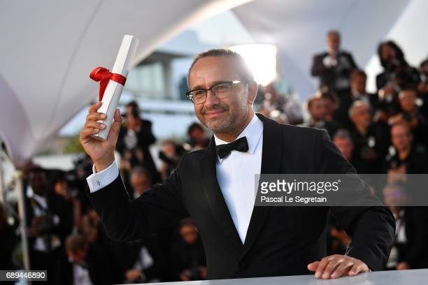 Andrey Zvyagintsev winner of the Prix Du Jury for the movie Loveless attends the Palme D'Or winner photocall during the 70th annual Cannes Film...