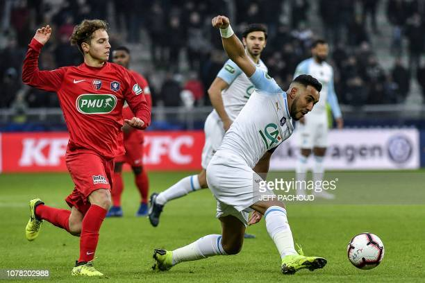 Andrezieux' French midfielder Noe Cabezas fights for the ball with Marseille's French midfielder Dimitri Payet during the French Cup last64 football...