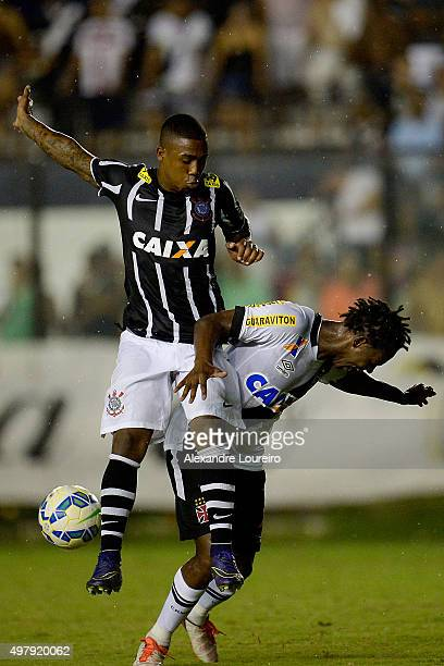 Andrezinho of Vasco battles for the ball with Malcom of Corinthians during the match between Vasco and Corinthians as part of Brasileirao Series A...