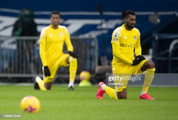 André-Frank Zambo Anguissa of Fulham takes the knee prior to the Premier League match between West Bromwich Albion and Fulham at The Hawthorns on...
