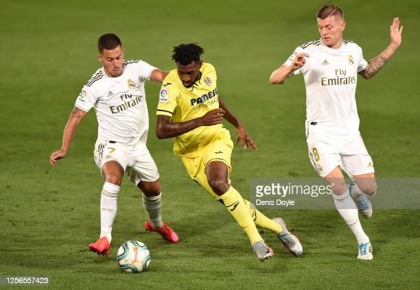 André-Frank Zambo Anguissa of Villarreal holds off Eden Hazard and Toni Kroos of Madrid during the Liga match between Real Madrid CF and Villarreal...