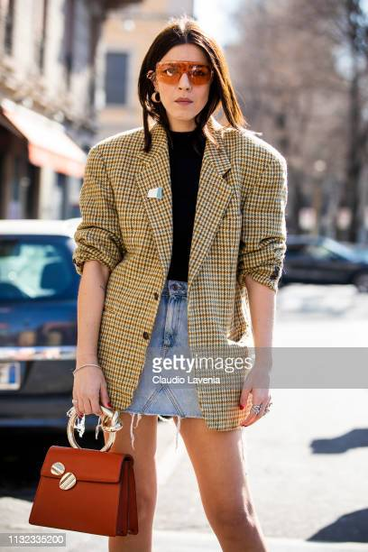 Andria Aletrari, checked jacket, denim skirt and orange bag and sunglasses is seen outside Laura Biagiotti on Day 5 Milan Fashion Week Autumn/Winter...